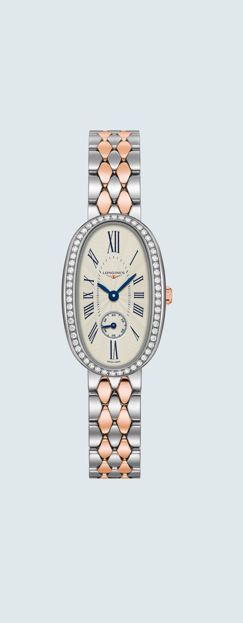 """21.90 X 34.00 mm Stainless steel with 18 karat pink gold crown case with Silver """"flinqué"""" dial and"""