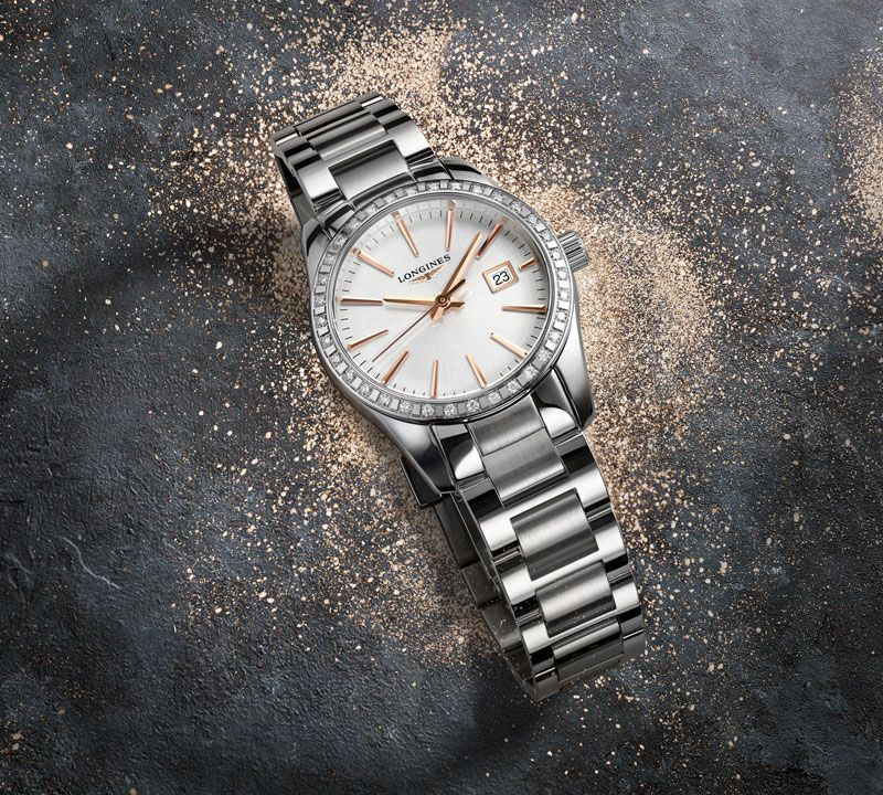 34.00 mm Stainless steel case with Sunray silver dial and Stainless steel strap
