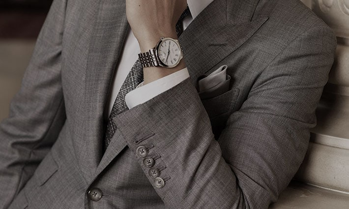 A man is wearing a Longines watch